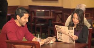 Two people reading Coffee News®